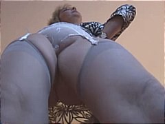 Blonde mature strips and shows off he...
