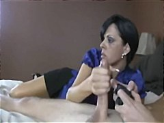 Nuvid - Mom gives handjob to guy while he plays on PS2