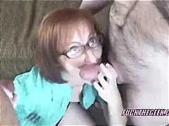 Redhead MILF Layla is sucking two sti...