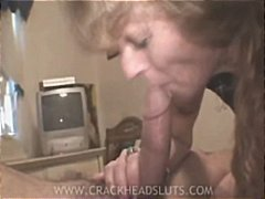 Mature crackhead slut sucking on cock to pay for her next high