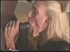 Blonde mature sucks on a black cock a...