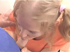 Young blonde pigtailed girl is gettin...