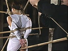 Asain gal gets bound and bamboo gagge...