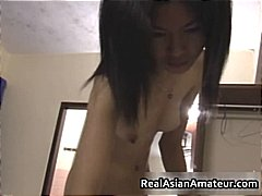 Horny Asian amateur di...