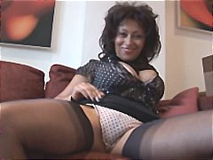 Big tits mature talks dirty as she st...