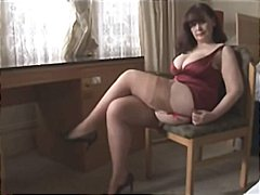 Big tits mature milf shows off sheer panties and stockings