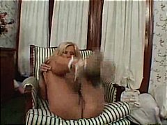 Bodacious housewife, slips a digit in her tempting pussy