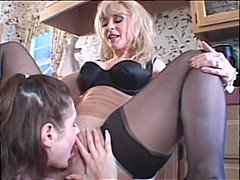 Nina Hartley straps on...