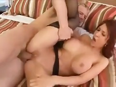Fake boobs redhead on her back for dick
