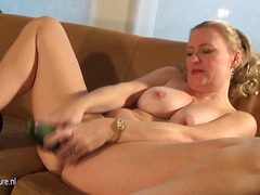 Horny mature housewife riding a cucumber