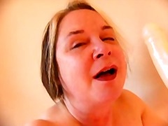 Old Slut Fucking Her Throat With A Dildo