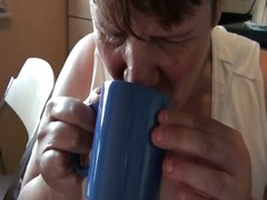 Germa mature drinking coffee with cum...