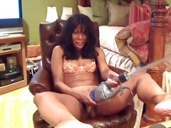Thumb: Black milf plays with ...