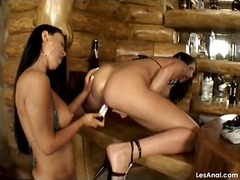 Lesbian anal sex on the bar counter