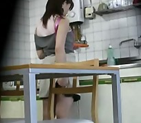 Caught woman masturbates in kitchen