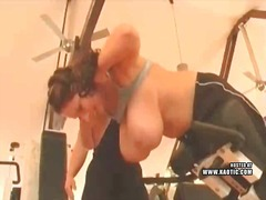 Big titted babe works out using boobs