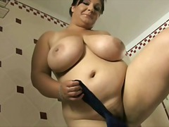Busty milf in bathroom preview