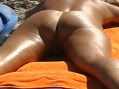Thumb: Beach spread on a nude...