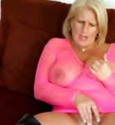 Busty mature in bodystocking & boots ...