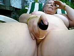Big titted Mature slut masturbates ou...