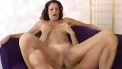MILF fucks all over purple sofa