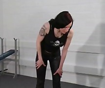 Tattooed skinny mistress makes her male slave do her bidding