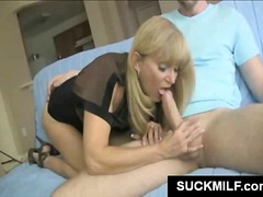 Blonde MILF gives oral sex