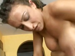 Busty naked blonde slut on the kitchen table gets her wet pussy and ass fucked hard