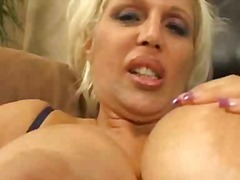 Busty mature gives titfuck after shag