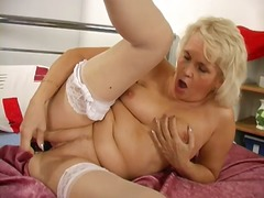Thumbmail - Blonde granny uses fin...