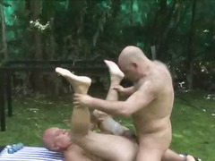 Mature studs play anal games outdoors