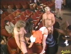 Sexy whore gangbanged in a theater