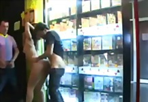 Handcuffed babe gangbanged in porn store