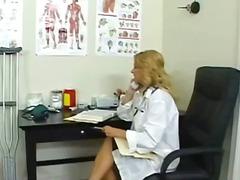 See: Busty blonde doctor in...