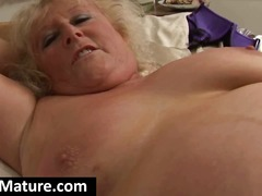 Chubby blonde granny squeezes her big...