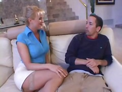 Busty blonde MILF takes out his cock ...