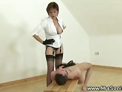 Equestrian riding her slaves face