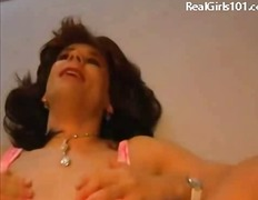 Mature tranny gets anal at home