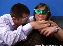 Italian couple wear masks and film th...