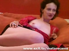 mature Redhead Nicolle playing at home