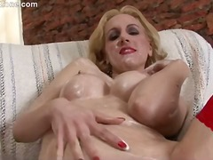 Busty mature blonde Paulina rubs whip...