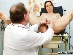 Doctor inspecting a mature mom her pussy part6