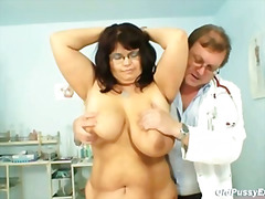 Mature Daniela has her huge tits chec...