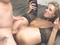Blonde milf in leather...
