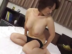 Japanese MILF Seduces Young Man xLx