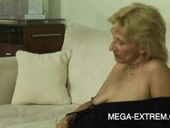 Hot blonde milf fucks her pussy with ...