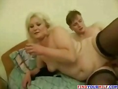 Chubby blonde mature Russian gives head an...