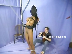 Black busty lady crucified on bondage...