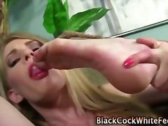 Tiny white chick gets footjerking on some ebony cock