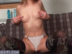 Cute blonde shows off her ass as she ...